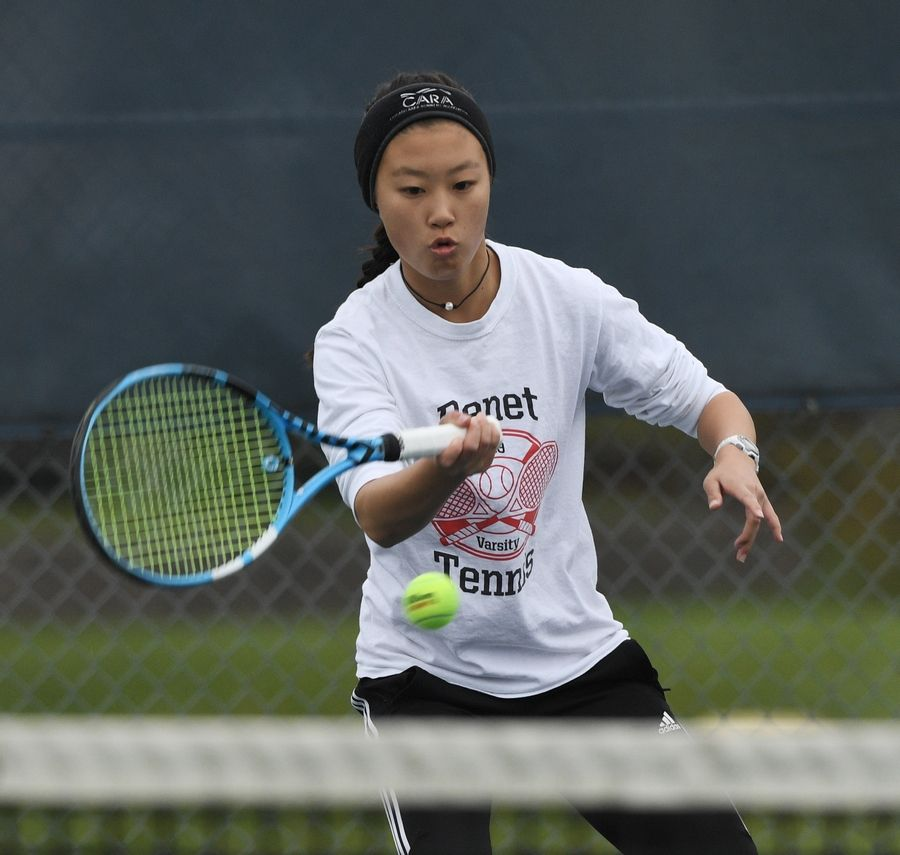 Benet Academy's Kaitlyn Lee returns the ball during the girls state tennis Class 1A doubles championship at Buffalo Grove High School last season.