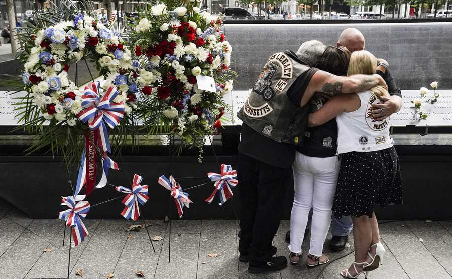 Associated Press Mourners hug beside the names of the deceased Jesus Sanchez and Marianne MacFarlane at the National September 11 Memorial and Museum, Friday, Sept. 11, 2020, in New York. Americans commemorated 9/11 with tributes that have been altered by coronavirus precautions and woven into the presidential campaign. (AP Photo/John Minchillo)
