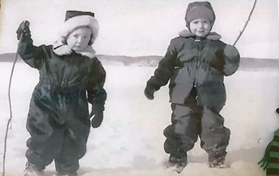 Susan Anderson-Khleif with her brother, Nic, in snowsuits playing on a frozen lake in Minnesota as children.