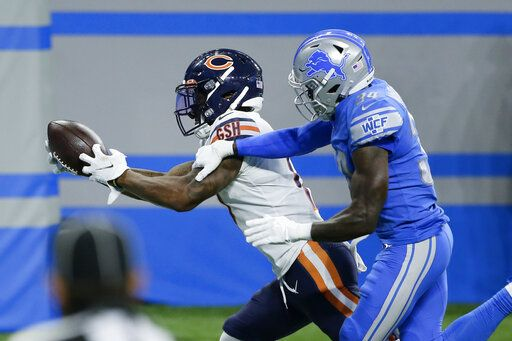 Chicago Bears wide receiver Anthony Miller catches a 27-yard touchdown pass as Detroit Lions cornerback Tony McRae (34) defends in the second half of an NFL football game in Detroit, Sunday, Sept. 13, 2020. Chicago won 27-23.