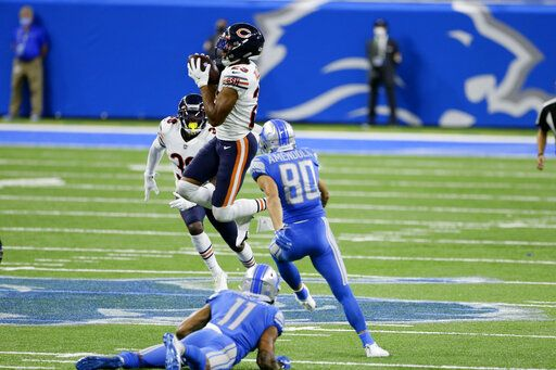 Chicago Bears cornerback Kyle Fuller (23) intercepts a Detroit Lions quarterback Matthew Stafford (9) pass in the fourth quarter of an NFL football game in Detroit, Sunday, Sept. 13, 2020. Chicago won 27-23.