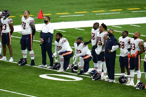 Chicago Bears' Bobby Massie (70) and Charles Leno Jr. (72) kneel during social justice video before an NFL football game against the Detroit Lions in Detroit, Sunday, Sept. 13, 2020.