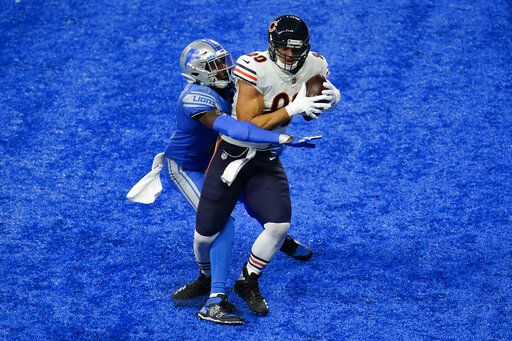 Chicago Bears tight end Jimmy Graham (80) catches a two-yard touchdown pass as Detroit Lions defensive back Tracy Walker (21) defends in the second half of an NFL football game in Detroit, Sunday, Sept. 13, 2020.
