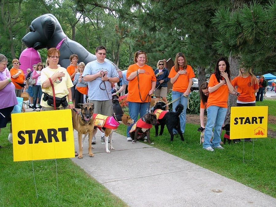 Walkers and their dogs get ready for the start of a previous Barkapalooza fundraiser for the West Suburban Humane Society in Downers Grove. This year's event will be virtual.