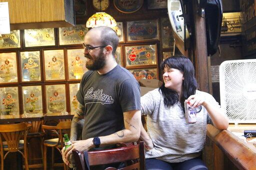 Zach Preston and his wife Allie Preston are regulars at The Leon Pub in Tallahassee, Fla. They spent Monday night, Sept. 14, 2020, at the once-popular watering hole. The pub hopes that more of its patrons will begin returning to help revive business in the wake of the coronavirus pandemic.