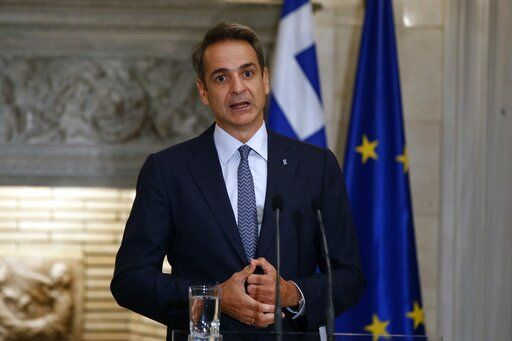 Greece's Prime Minister Kyriakos Mitsotakis makes statements after his meeting with European Council President Charles Michel at Maximos Mansion in Athens, Tuesday, Sept. 15, 2020. Michel will visit Lesbos later today as Greece's migration minister says the government will use force if necessary to move homeless migrants to a new facility on the island after thousands of people were left without shelter by fires last week at an overcrowded refugee camp.