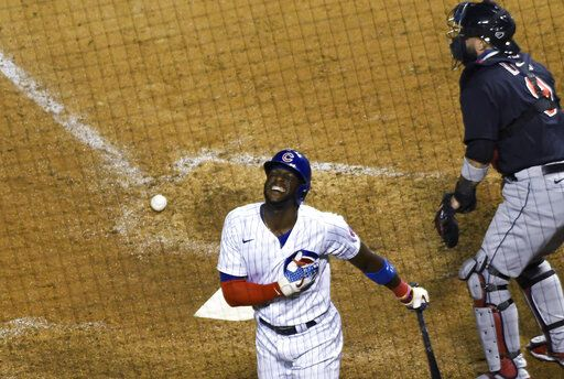 Chicago Cubs' Cameron Maybin reacts after being hit by a pitch with the bases loaded, scoring the winning run during the ninth inning of the team's baseball game against the Cleveland Indians, Tuesday, Sept.15, 2020, in Chicago.