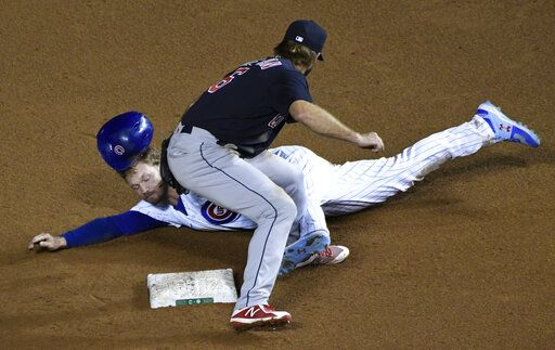 Cleveland Indians second baseman Mike Freeman (6) tags out Chicago Cubs' Ian Happ (8) at second base on a steal attempt during the seventh inning of a baseball game, Tuesday, Sept.15, 2020, in Chicago.