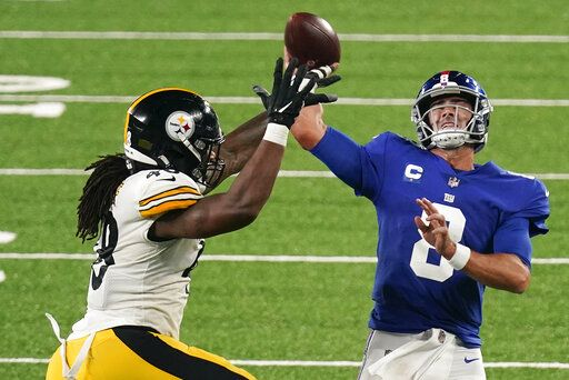 New York Giants quarterback Daniel Jones (8) throws under pressure from Pittsburgh Steelers outside linebacker Bud Dupree (48) during the third quarter of an NFL football game Monday, Sept. 14, 2020, in East Rutherford, N.J.