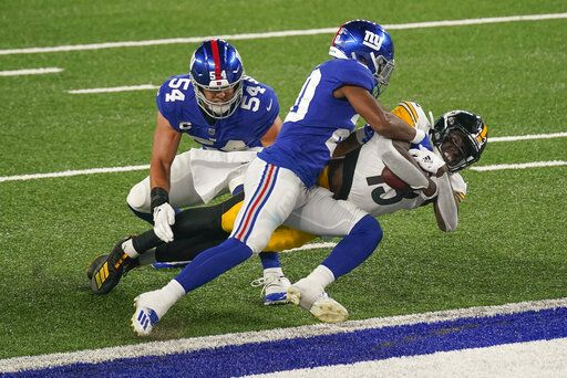 Pittsburgh Steelers wide receiver James Washington (13) pushes past New York Giants cornerback Julian Love (20) and inside linebacker Blake Martinez (54) to cross the goal line for a touchdown during the second quarter of an NFL football game Monday, Sept. 14, 2020, in East Rutherford, N.J.