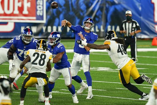 New York Giants quarterback Daniel Jones (8) passes under pressure from Pittsburgh Steelers outside linebacker Bud Dupree (48) during the second quarter of an NFL football game Monday, Sept. 14, 2020, in East Rutherford, N.J.