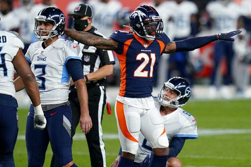 Denver Broncos cornerback A.J. Bouye (21) signals a missed field goal as Tennessee Titans kicker Stephen Gostkowski (3) watches the ball miss the uprights during the first half of an NFL football game, Monday, Sept. 14, 2020, in Denver.