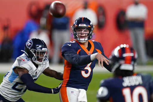 Denver Broncos quarterback Drew Lock (3) throws under pressure from Tennessee Titans cornerback Kristian Fulton (26) during the second half of an NFL football game, Monday, Sept. 14, 2020, in Denver.