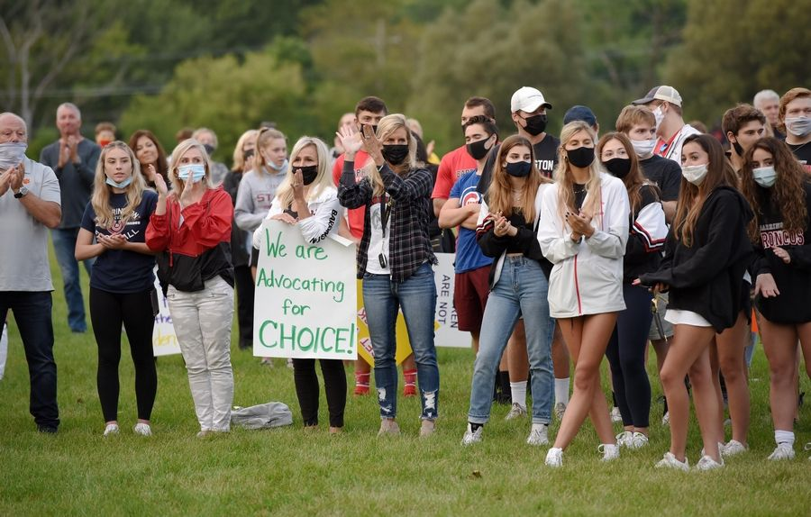"Parents and students in Barrington Area Unit District 220 hold a ""back-to-school"" rally at Citizens Park in Barrington Monday evening."