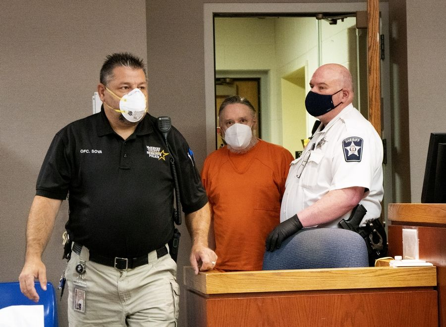 Andrew Freund Sr. enters a McHenry County courtroom in Woodstock Wednesday for a status hearing with Judge Robert A. Wilbrandt on Wednesday. A hearing is set for Friday to discuss a possible plea deal.