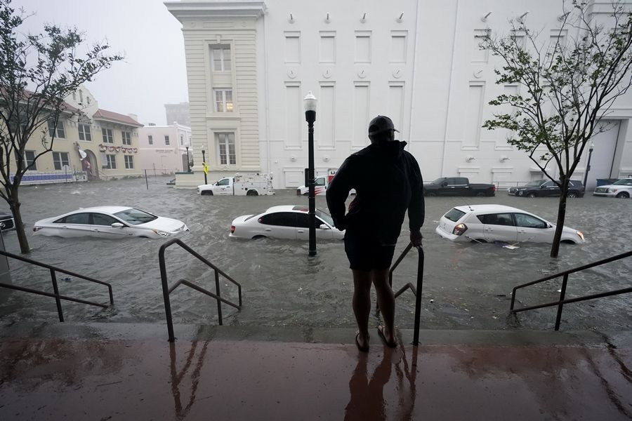 Floodwaters move on the street Wednesday in downtown Pensacola, Florida. Hurricane Sally made landfall Wednesday near Gulf Shores, Alabama, as a Category 2 storm, pushing a surge of ocean water onto the coast and dumping torrential rain that forecasters said would cause dangerous flooding from the Florida Panhandle to Mississippi and well inland in the days ahead.