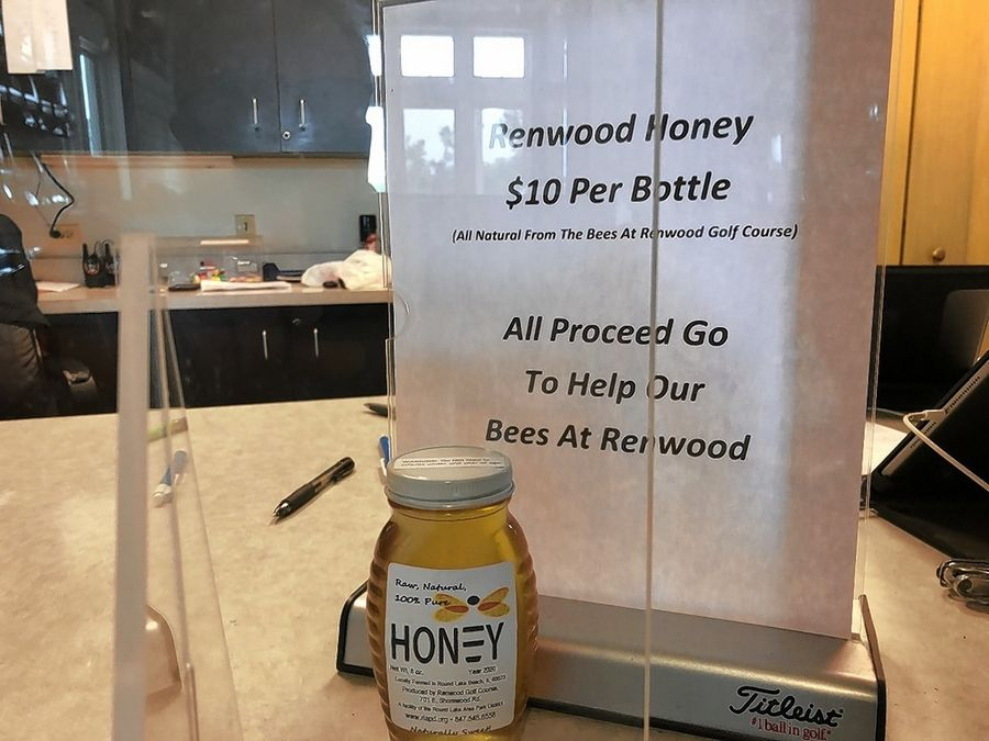 Bottles of honey produced on site are sold at the Renwood Golf Course in Round Lake Beach.