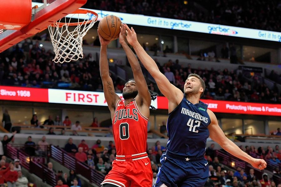 The Bulls' Coby White attempts to dunk against the Dallas Mavericks' Maxi Kleber in a March game at the United Center.