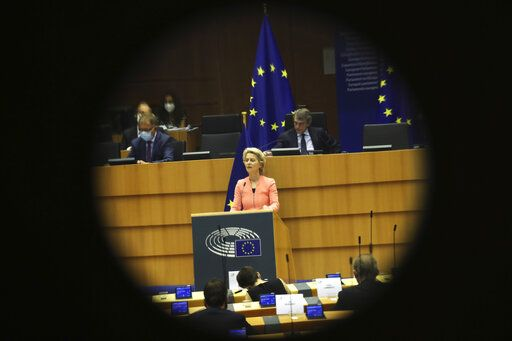 European Commission President Ursula von der Leyen addresses the plenary during her first State of the Union speech at the European Parliament in Brussels, Wednesday, Sept. 16, 2020. European Commission President Ursula von der Leyen will set out her vision of the future in her first State of the European Union address to the EU legislators. Weakened by the COVID-19 pandemic and the departure of the United Kingdom, she will center her speech on how the bloc should adapt to the challenges of the future, including global warming, the switch to a digital economy and immigration.