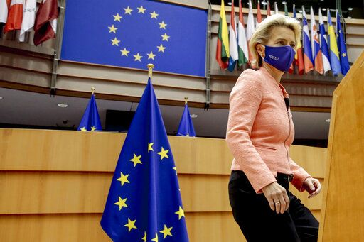 European Commission President Ursula von der Leyen arrives at the plenary ahead of her first State of the Union speech at the European Parliament in Brussels, Wednesday, Sept. 16, 2020. European Commission President Ursula von der Leyen will set out her vision of the future in her first State of the European Union address to the EU legislators. Weakened by the COVID-19 pandemic and the departure of the United Kingdom, she will center her speech on how the bloc should adapt to the challenges of the future, including global warming, the switch to a digital economy and immigration. (Olivier Hoslet, Pool via AP)