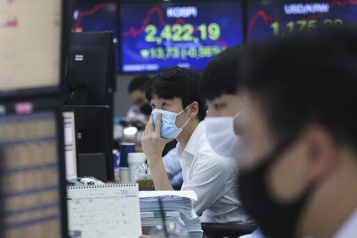 A currency trader watches monitors at the foreign exchange dealing room of the KEB Hana Bank headquarters in Seoul, South Korea, Thursday, Sept. 17, 2020. Asian stock markets declined Thursday after the U.S. Federal Reserve indicated its benchmark interest rate will stay close to zero at least through 2023 but announced no additional stimulus plans.