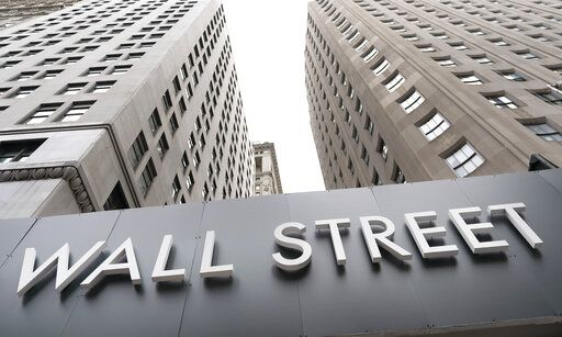 FILE - In this Aug. 31, 2020 file photo, buildings line Wall Street, in New York.  Stocks are ticking higher in early Wednesday, Sept. 16,  trading on Wall Street, ahead of a decision on interest-rate policy by the Federal Reserve scheduled for the afternoon.