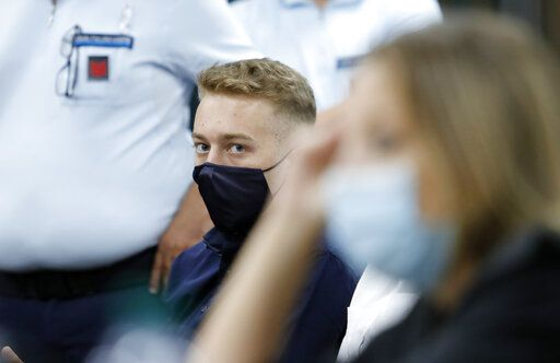 Finnegan Lee Elder, from California, looks on during a break in his trial where he and his friend Gabriel Natale-Hjorth are accused of slaying a plainclothes Carabinieri officer while on vacation in Italy last summer, in Rome, Wednesday, Sept. 16, 2020. (Remo Casilli/Pool Photo via AP)