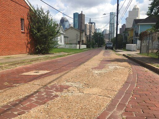 In this Sept. 27, 2017 photo are the cobblestone streets of Freedmen's Town, an area built by emancipated slaves after the Civil War in Houston. The area is believed to have been connected to the Underground Railroad to Mexico. Across Texas and parts of Louisiana, Alabama, and Arkansas, scholars and preservation advocates are working to piece together a puzzle of a largely forgotten piece of American history: a network that helped thousands of Black slaves escape to Mexico.