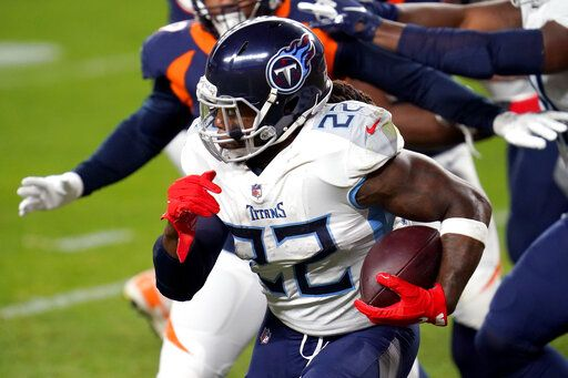 Tennessee Titans running back Derrick Henry (22) runs during the first half of an NFL football game against the Denver Broncos, Monday, Sept. 14, 2020, in Denver.
