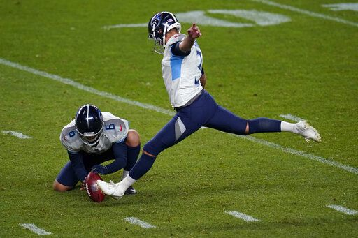 Tennessee Titans kicker Stephen Gostkowski approaches his field goal attempt as punter Brett Kern (6) holds during the second half of an NFL football game against the Denver Broncos, Monday, Sept. 14, 2020, in Denver. Gostkowski missed the attempt.