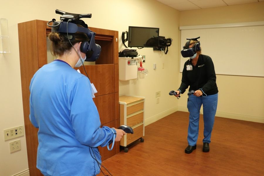 Alison Keck, RN and Tanya Layman, RN, practice providing patient care using a virtual reality system at Northwestern Medicine Central DuPage HospitalKim Waterman