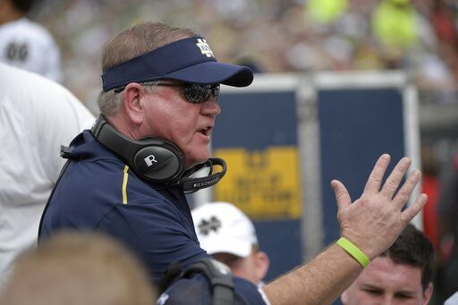 File-Notre Dame head coach Brian Kelly talks to players at the bench during the Camping World Bowl NCAA college football game against Iowa State Saturday, Dec. 28, 2019, in Orlando, Fla. The 58-year-old Kelly begins his 11th season at Notre Dame when the 10th-ranked Fighting Irish, taking a one-year sabbatical from football independence to join the Atlantic Coast Conference race, open against league rival Duke Sept. 12 at Notre Dame Stadium.