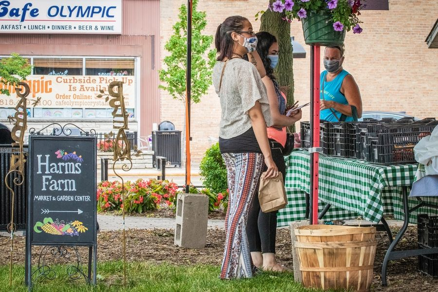 Visitors enjoy a recent Crystal Lake Farmers Market outing. Visit McHenry County is hard at work promoting the area's many offerings -- along with COVID-19 protocols -- to offset pandemic-prompted losses after years of tourism growth.