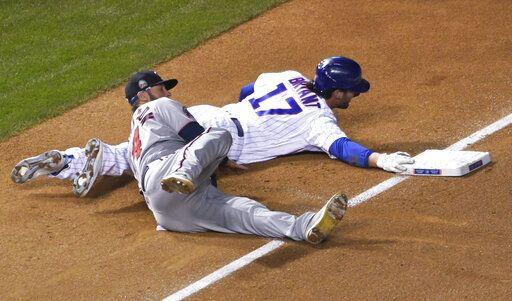Minnesota Twins third baseman Josh Donaldson (24) tags out Chicago Cubs' Kris Bryant (17) at third base during the first inning of a baseball game, Friday, Sept. 18, 2020, in Chicago.