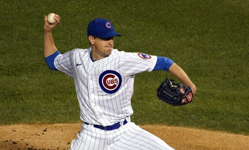 Chicago Cubs starting pitcher Kyle Hendricks delivers against the Minnesota Twins during the first inning of a baseball game, Friday, Sept. 18, 2020, in Chicago.
