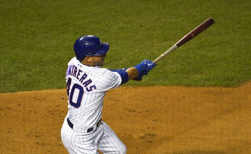 Chicago Cubs' Willson Contreras hits a one-run single against the Minnesota Twins during the first inning of a baseball game, Friday, Sept. 18, 2020, in Chicago.