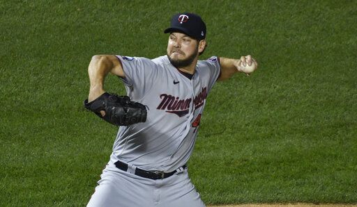 Minnesota Twins starting pitcher Rich Hill delivers against the Chicago Cubs during the first inning of a baseball game, Friday, Sept. 18, 2020, in Chicago.