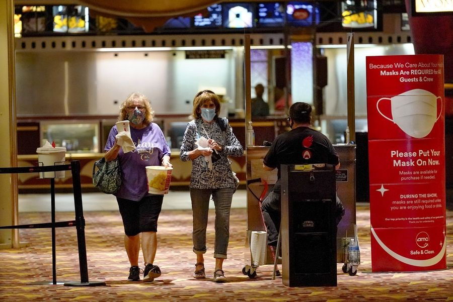 Patrons attend one of the first showings at an AMC theater when it reopened after shutting down at the start of the COVID-19 pandemic, Thursday, Aug. 20, 2020, in West Homestead, Pa.