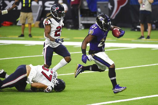 Baltimore Ravens running back Mark Ingram (21) runs for a touchdown against the Houston Texans during the second half of an NFL football game Sunday, Sept. 20, 2020, in Houston.