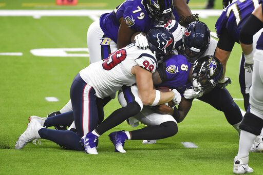 Baltimore Ravens quarterback Lamar Jackson (8) is sacked by Houston Texans defensive end J.J. Watt (99) during the first half of an NFL football game Sunday, Sept. 20, 2020, in Houston.