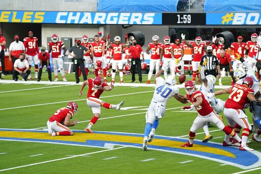 Kansas City Chiefs kicker Harrison Butker (7) hits the game-winning field goal during overtime of an NFL football game against the Los Angeles Chargers Sunday, Sept. 20, 2020, in Inglewood, Calif. Kansas City won 23-20.