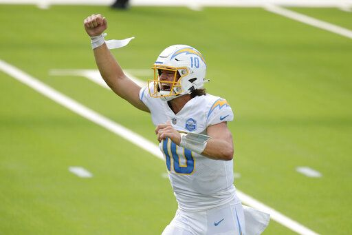 Los Angeles Chargers quarterback Justin Herbert celebrates after throwing his first career touchdown pass during the first half of an NFL football game against the Kansas City Chiefs Sunday, Sept. 20, 2020, in Inglewood, Calif.
