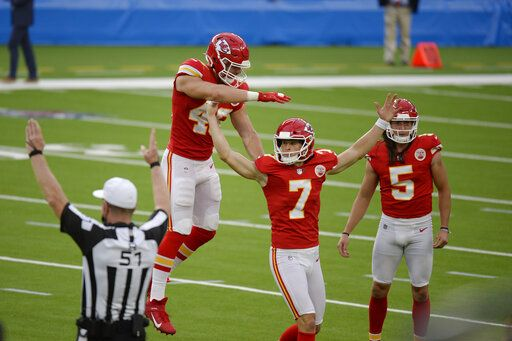 Kansas City Chiefs kicker Harrison Butker (7) celebrates after making the game-winning field goal during overtime of an NFL football game against the Los Angeles Chargers Sunday, Sept. 20, 2020, in Inglewood, Calif. Kansas City won 23-20.