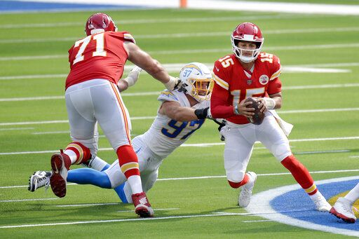 Kansas City Chiefs quarterback Patrick Mahomes, right, is tackled by Los Angeles Chargers defensive end Joey Bosa, center, during the second half of an NFL football game Sunday, Sept. 20, 2020, in Inglewood, Calif.