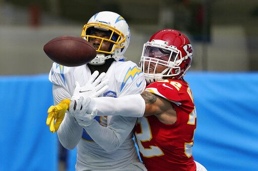 Kansas City Chiefs free safety Tyrann Mathieu, right, breaks up a pass intended for Los Angeles Chargers wide receiver Mike Williams during the first half of an NFL football game Sunday, Sept. 20, 2020, in Inglewood, Calif.