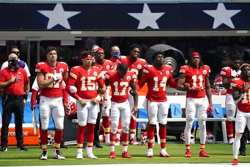 Kansas City Chiefs player lock arms as the national anthem plays before an NFL football game against the Los Angeles Chargers Sunday, Sept. 20, 2020, in Inglewood, Calif.
