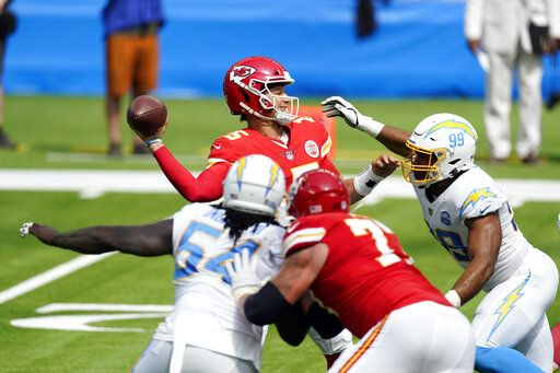 Kansas City Chiefs quarterback Patrick Mahomes throws under pressure agains the Los Angeles Chargers during the first half of an NFL football game Sunday, Sept. 20, 2020, in Inglewood, Calif.