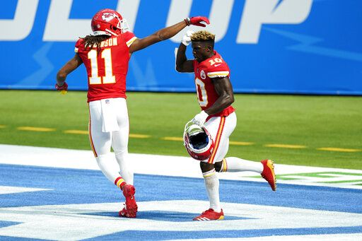 Kansas City Chiefs wide receiver Tyreek Hill, right, celebrates his touchdown catch with wide receiver Demarcus Robinson (11) during the second half of an NFL football game against the Los Angeles Chargers Sunday, Sept. 20, 2020, in Inglewood, Calif.