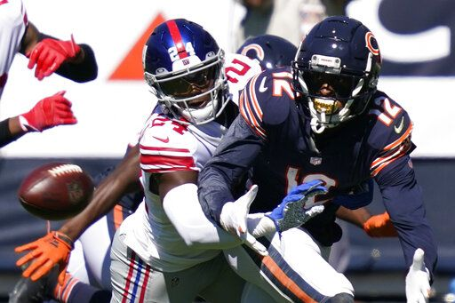 New York Giants cornerback James Bradberry (24) defends Chicago Bears wide receiver Allen Robinson (12) during the first half of an NFL football game in Chicago, Sunday, Sept. 20, 2020.