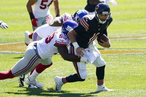 New York Giants linebacker Lorenzo Carter (59) sacks Chicago Bears quarterback Mitchell Trubisky (10) during the first half of an NFL football game in Chicago, Sunday, Sept. 20, 2020.
